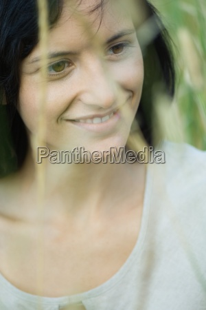 young woman smiling looking away portrait