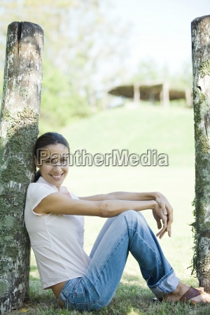 woman sitting on grass leaning against