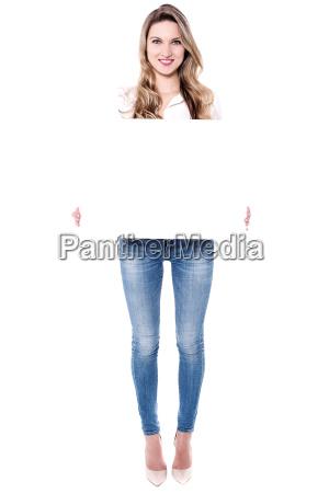 happy woman holding blank billboard