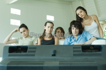 group of young friends watching tv