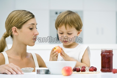 mother and son preparing food together