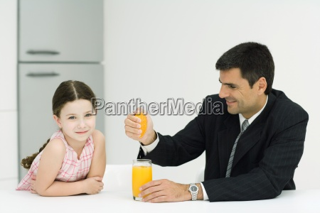 father and daughter sitting together at