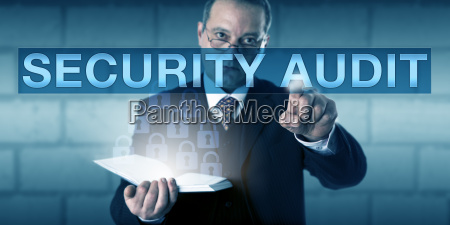 male corporate auditor touching security audit
