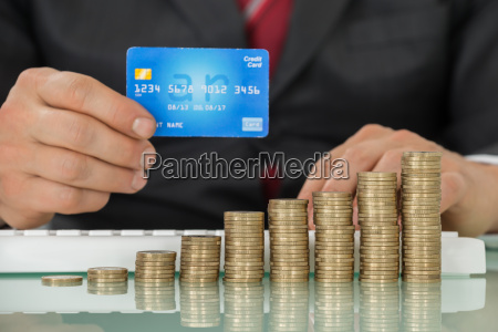 businessman using credit card and keyboard