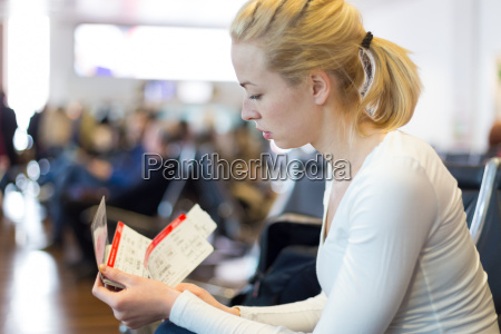 woman waiting on airport terminal