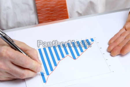 man working on graphic chart