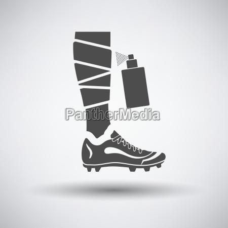 soccer bandaged leg with aerosol anesthetic