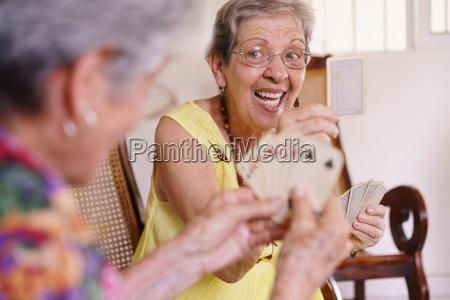 old women enjoy playing card game