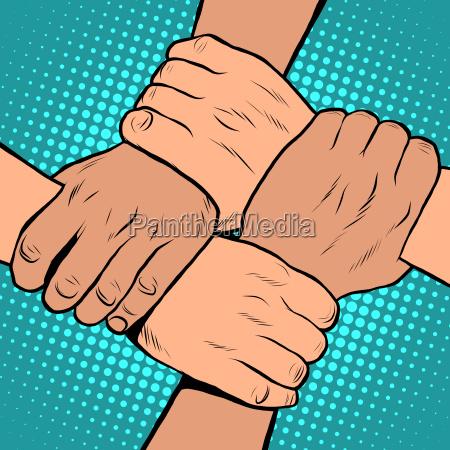white black solidarity handshake stop racism