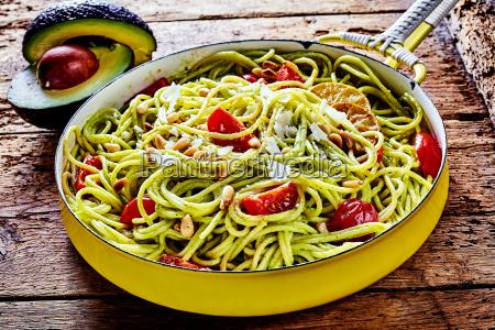 tasty italian pasta with avocado and