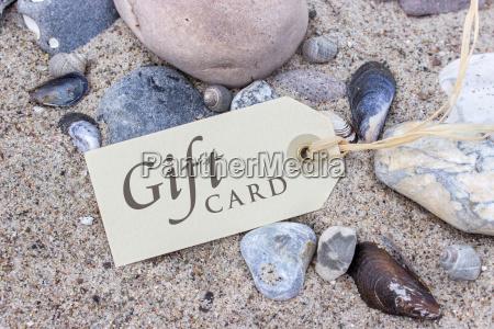 gift card on the sandy beach