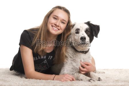 happy laughing girl hugs her dog