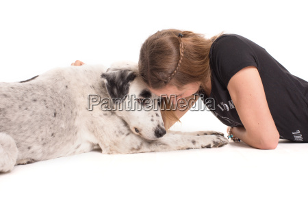 young girl cuddles with her dog