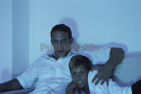 couple watching tv together at night