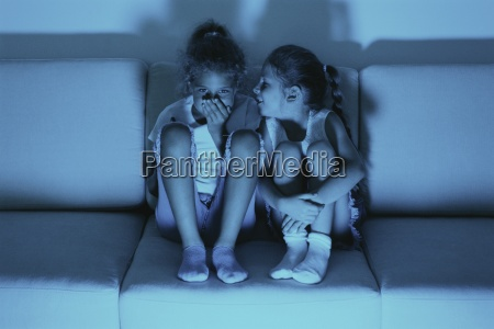 two girls watching tv together one