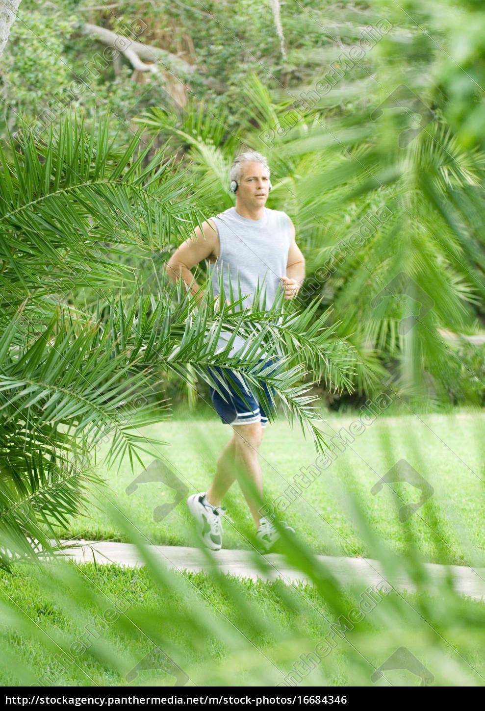 mature, man, jogging, on, walkway - 16684346