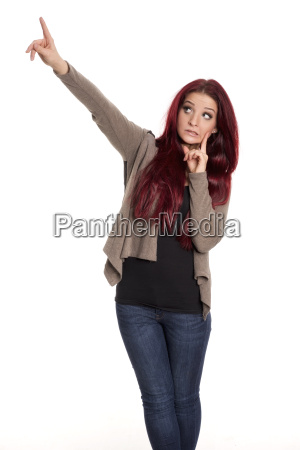 redhead woman pointing up and looking