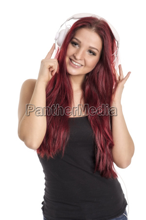 pretty red haired woman listening to