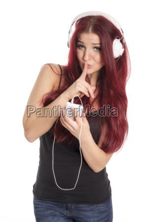 redheaded girl gestures psst