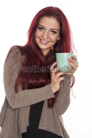 young red haired woman holding a