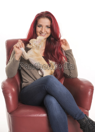 red haired woman sits with a