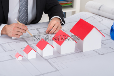 male architect hand working on blueprint