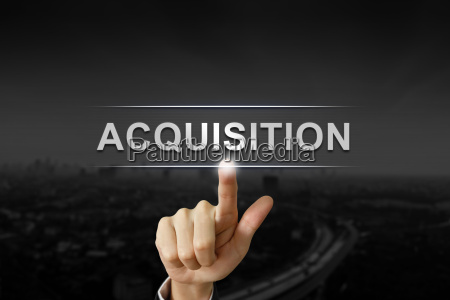 business hand pushing acquisition button on