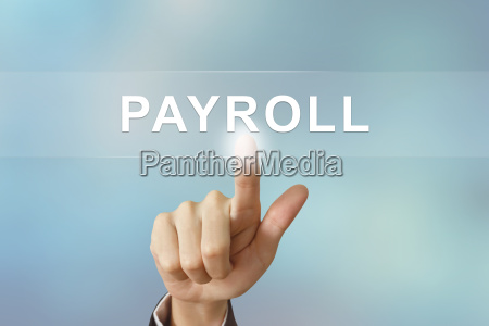 business hand clicking payroll button on