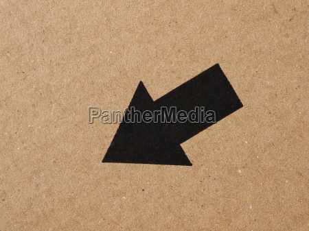 black arrow on cardboard