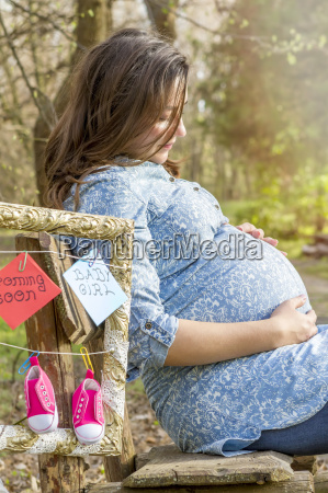 beautiful pregnant woman outdoor in the