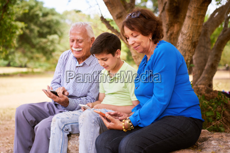 child helping grandparents going internet on