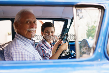 portrait grandpa giving driving lesson to