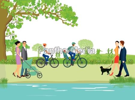 spaziergaenger und familien im park