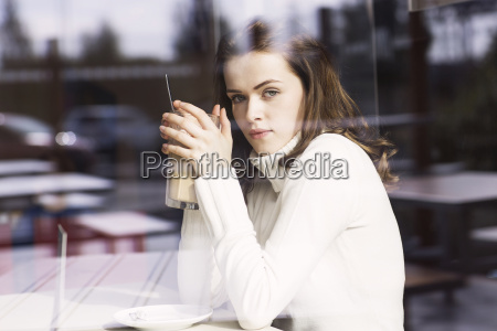 portrait of young woman with latte