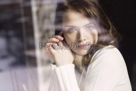 portrait of young woman looking through