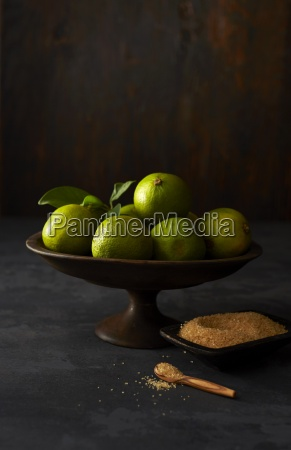fruit bowl with limes and bowl