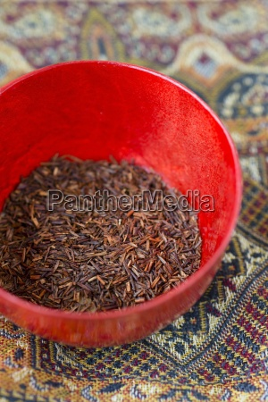 red bowl of dried rooibos tea