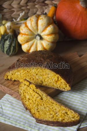 sliced pumpkin bread on wooden board