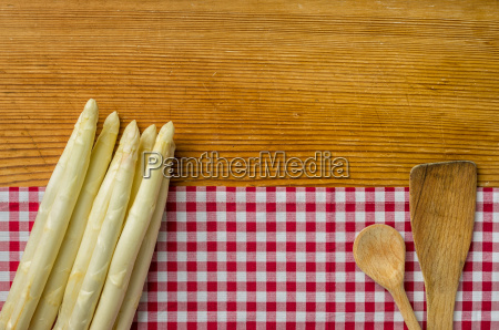asparagus on wood background with a