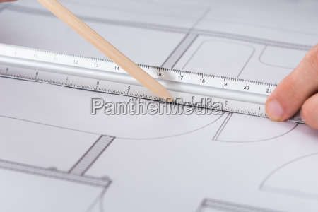 architect hand working on blueprint