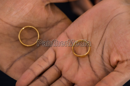 hands with golden rings