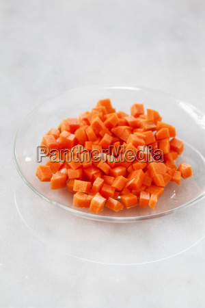 glass bowl of diced carrots on