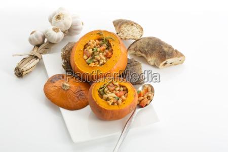 plate with baked hokkaido pumpkins filled