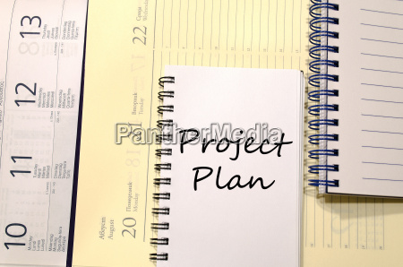 project plan write on notebook