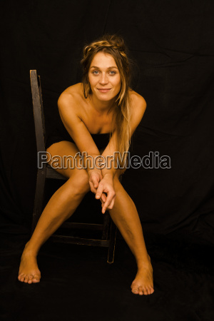 portrait of smiling woman wearing black