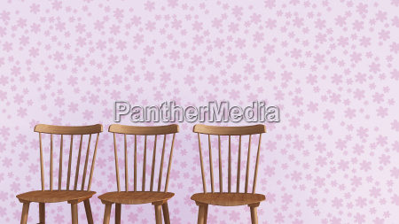 row of three wooden chairs in