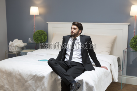 serious man in suit sitting on