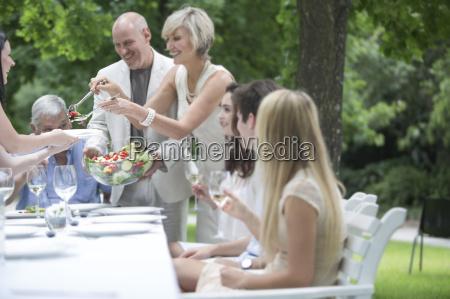 woman dishing up salad on a
