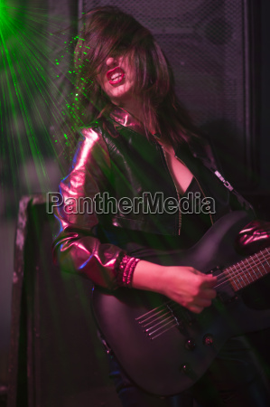 female rock guitar player with black