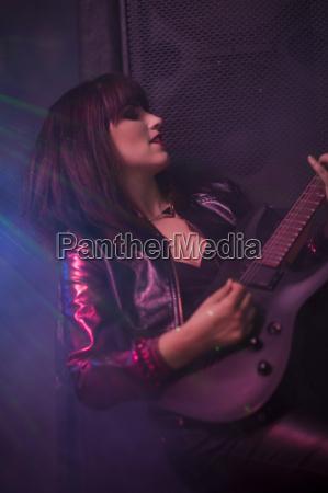 female rock guitar player
